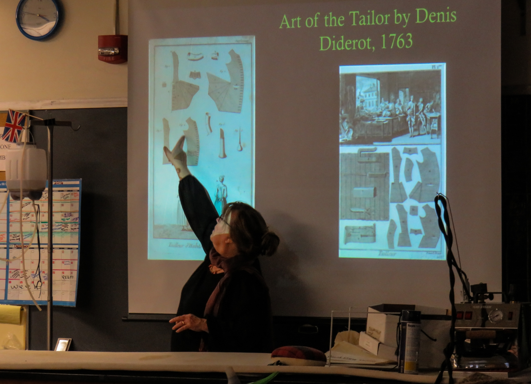 Niagara County Historian, Kate Emerson, presents historic details of the men's 18th century waistcoat to Niagara University students as a contributor to a collaborative project between Old Fort Niagara and the university.
