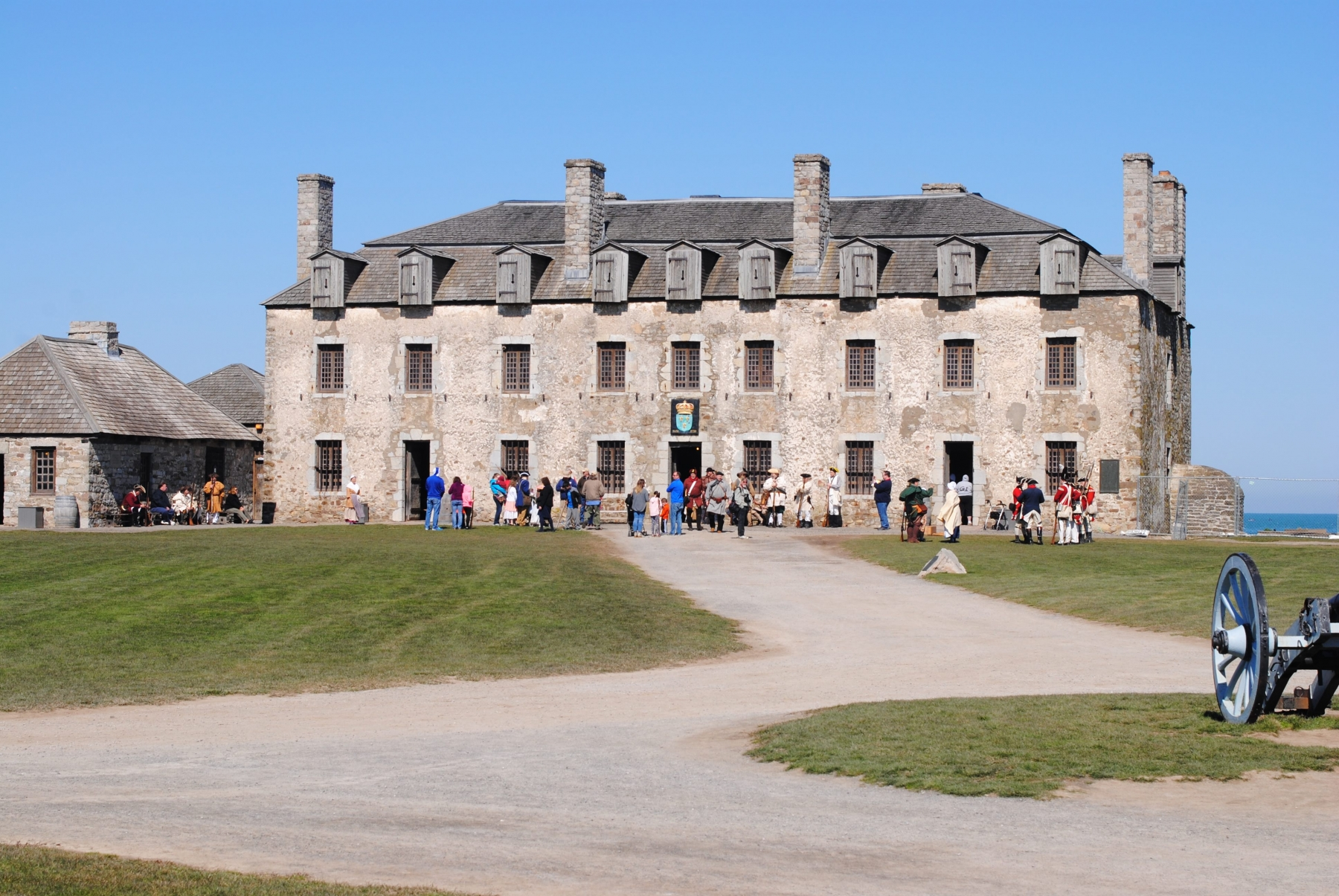 Reenactors and visitors mingle in front of the French Castle at Old Fort Niagara on Patriots Day Weekend. (photo C. Clark)