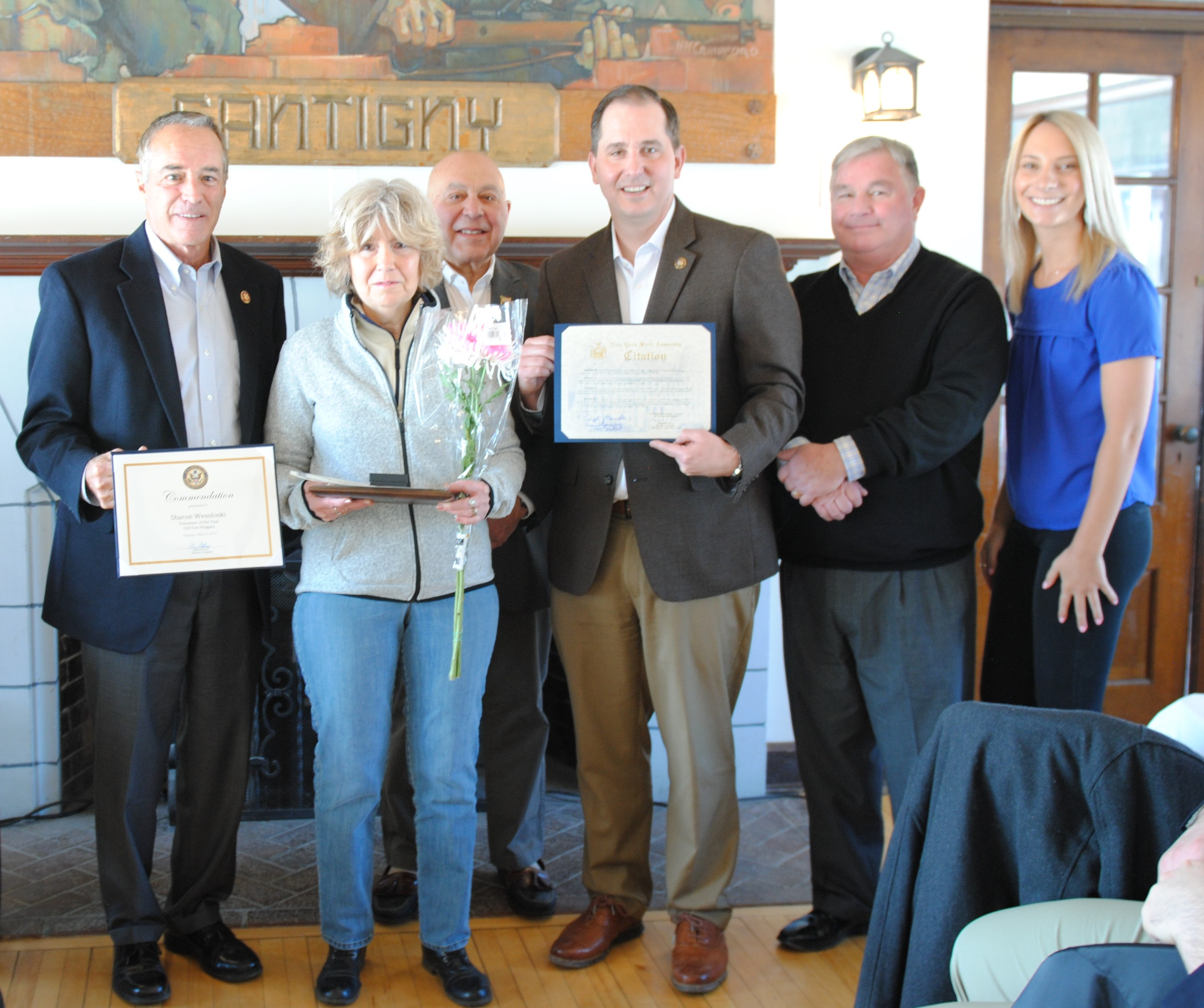 Sharon Wesoloski was named Old Fort Niagara Association's 2018 Volunteer of the Year and also received special awards from Congressman Chris Collins and State Assemblyman Mike Norris. State Assemblyman Angelo Morinello, Porter Town Councilman Tim Adamson and the fort's volunteer coordinator, Erika Schrader, are also pictured.