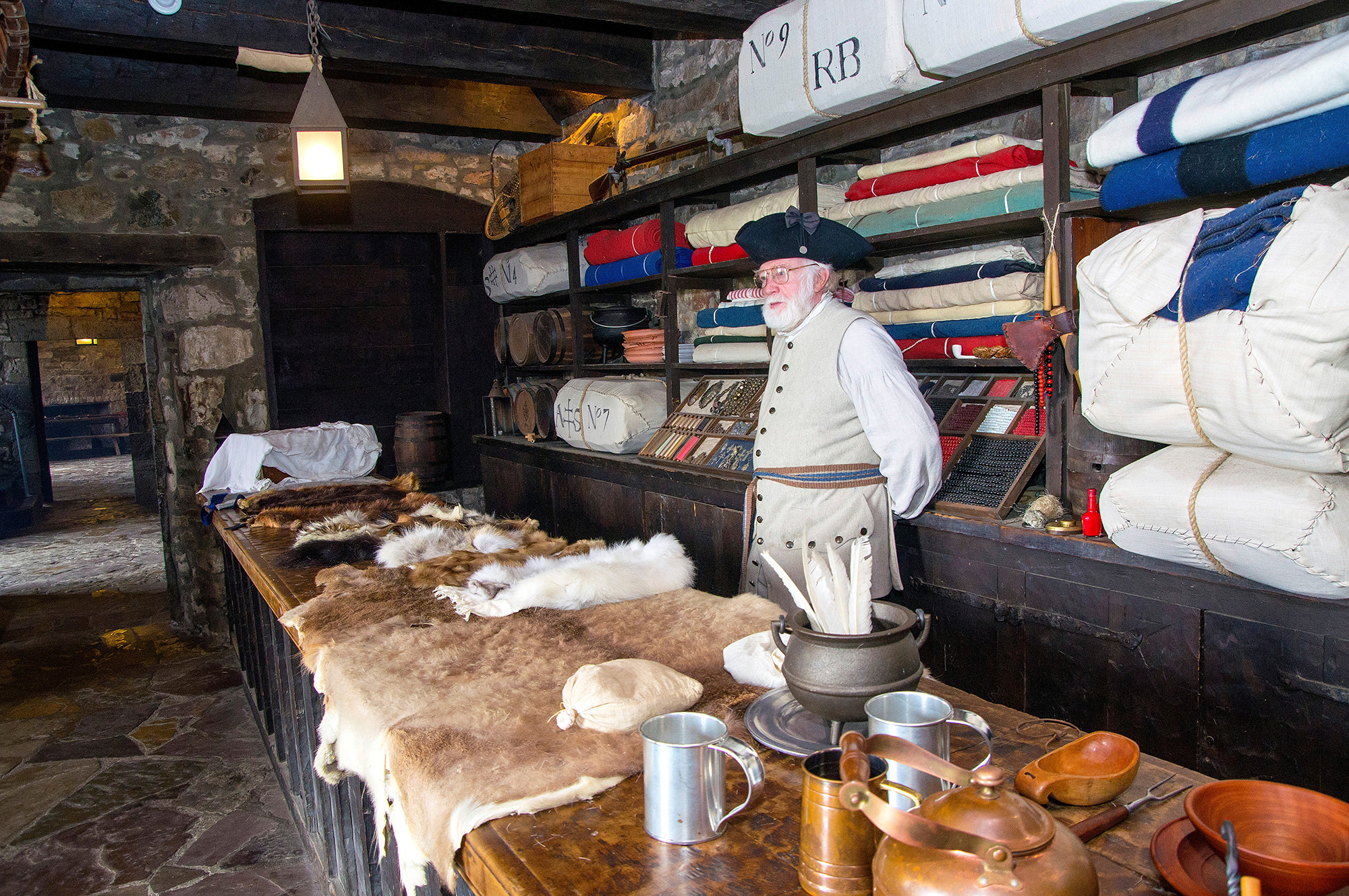 This is the fort's trade room, which saw decades of trade between the French and Native communities on the early Niagara frontier. Here, interpreter Art Hannah explains the types of furs that were traded, which visitors are encouraged to touch.